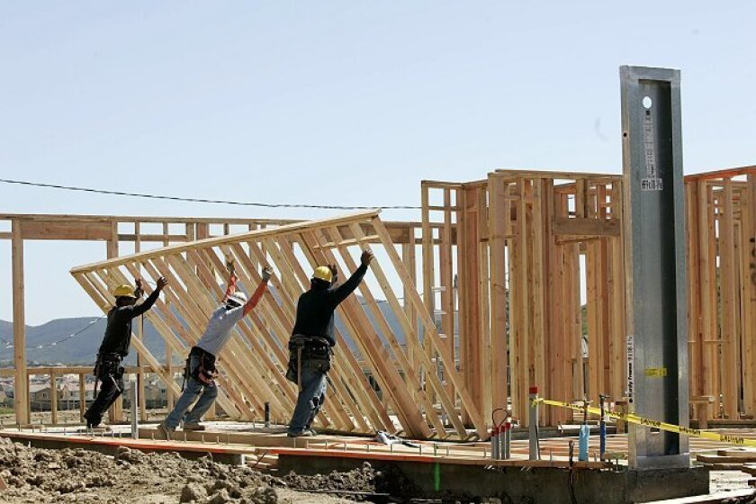 Construction workers frame up new homes in San Diego's 4S Ranch community