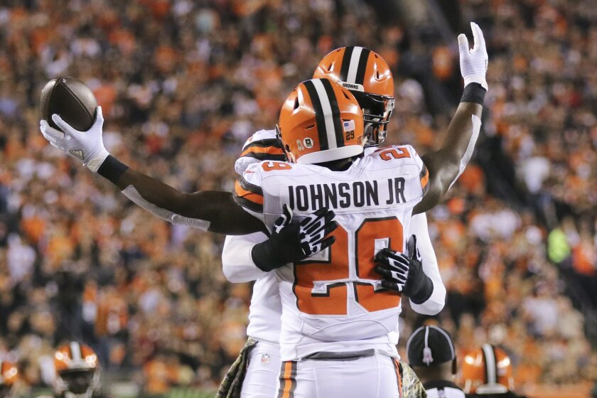 Cleveland Browns running back Duke Johnson (29) celebrates a touchdown with offensive tackle Cameron Erving in the first half of an NFL football game against the Cincinnati Bengals, Thursday, Nov. 5, 2015, in Cincinnati. (AP Photo/Frank Victores)