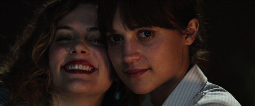 Riley Keough  and Alicia Vikander in 'Earthquake Bird'