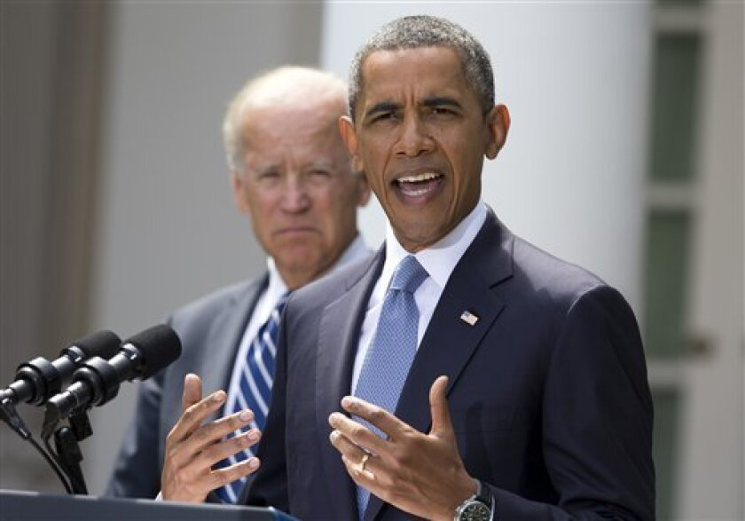 President Barack Obama, flanked by Vice President Joe Biden, left, speaks about the crisis in Syria in the Rose Garden of the White House on Saturday, Aug. 31, 2013 in Washington. Obama says he has decided that the United States should take military action against Syria in response to a deadly chem