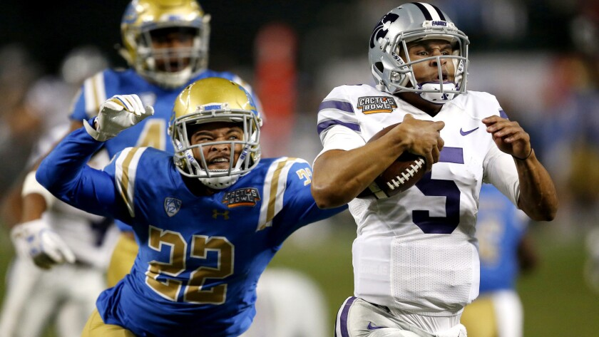 Kansas State quarterback Alex Delton (5) sprints 68 yards for a touchdown at the end of the first quarter as UCLA defensive back Nate Meadors (22) makes a last-ditch effort to stop him on Dec. 26, 2017 in the Cactus Bowl.