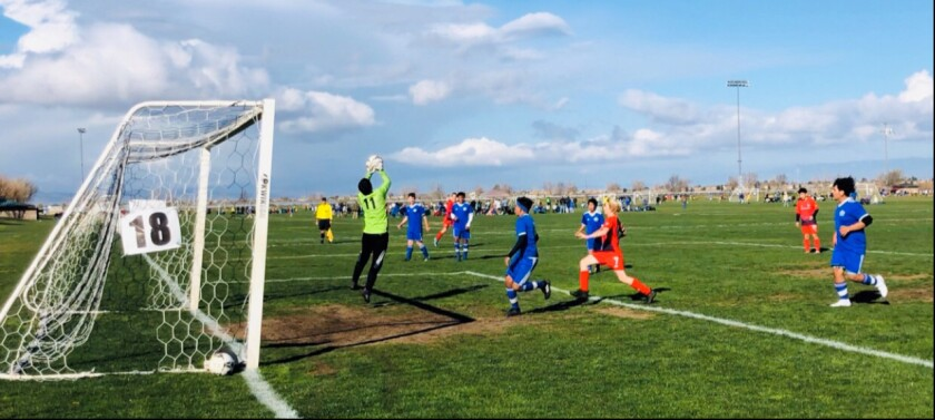 """Intra FC 2006 goalie Justus """"Jesse"""" Ballew makes one of several saves in game one at the State Cup tournament."""