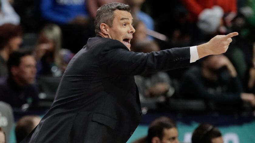 Virginia coach Tony Bennett motions to players during the second half of the team's NCAA college bas