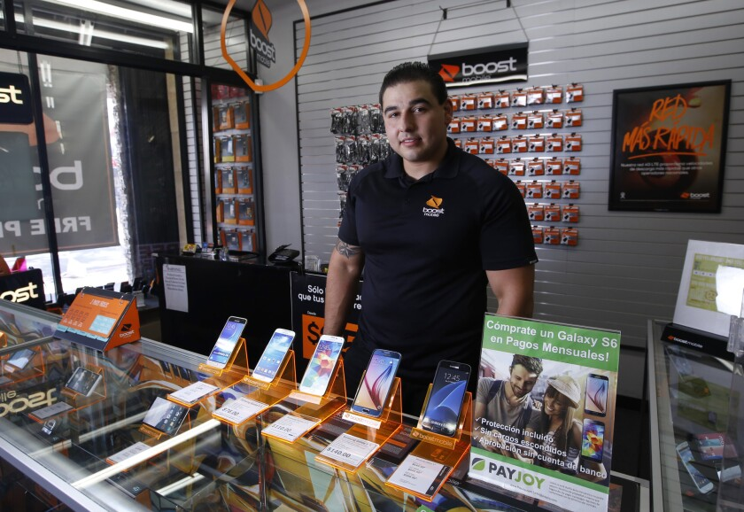 Gary Fuentes at La Fiesta Wireless in El Monte says more of his prepaid phone customers are buying high-end smartphones instead of cheaper models, thanks to a growing number of companies offering financing plans.