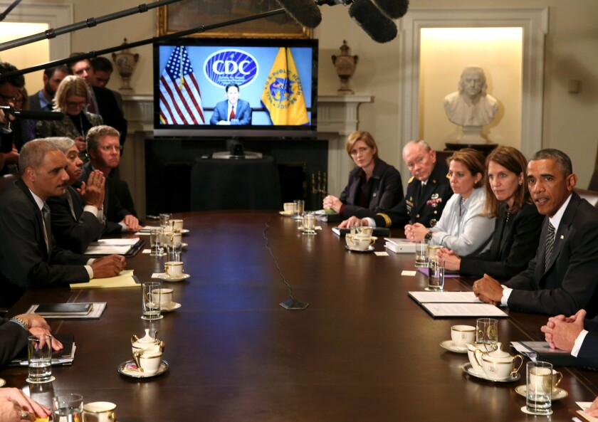 President Obama speaks with members of his cabinet about the fight against the Ebola virus during a meeting at the White House.