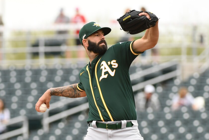 Oakland Athletics pitcher Mike Fiers delivers a first inning pitch against the Cincinnati Reds during a spring training game at Goodyear Ballpark on Feb. 28 in Goodyear, Ariz.