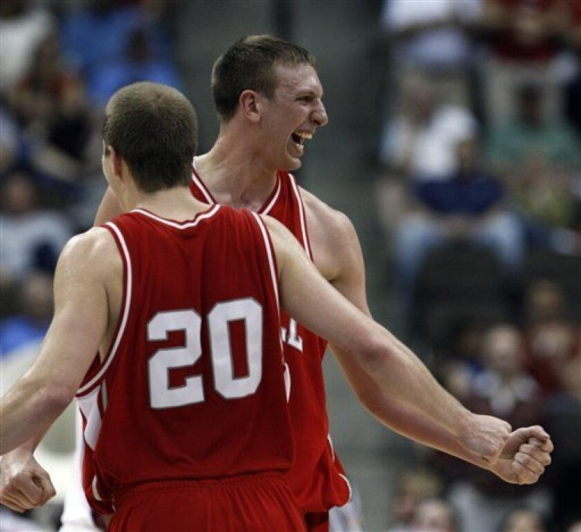 Cornell's Ryan Wittman (20) and Jeff Foote celebrate after defeating Temple 78-65 in an NCAA first-round college basketball game in Jacksonville, Fla., Friday, March 19, 2010.  (AP Photo/Wilfredo Lee)