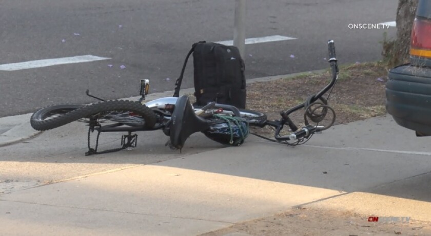A bicycle lies mangled on the ground after its rider was struck and killed Friday evening on Genesee Avenue in Clairemont.