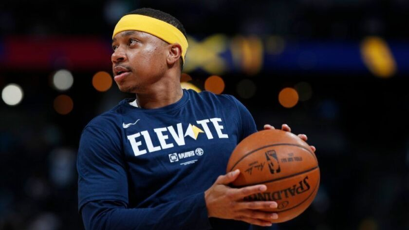 Denver Nuggets guard Isaiah Thomas (0), r m