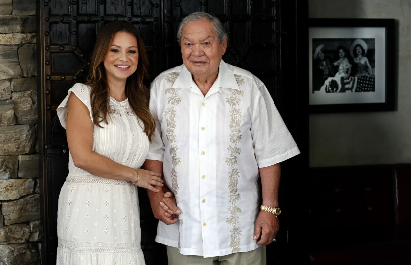 """Second-generation Casa Vega owner Christy Vega Fowler holds hands with her father, Rafael """"Ray"""" Vega."""