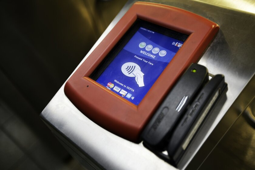 In this Dec. 2, 2014, photo, a computerized testing turnstile is seen at the Southeastern Pennsylvania Transportation Authority's 13th Street Station in Philadelphia. Philadelphia riders can now see evidence of SEPTA Key, the long-awaited smart card system for the Southeastern Pennsylvania Transportation Authority. Dozens of computerized kiosks, turnstiles and fare boxes have popped up in stations and on vehicles, and testing begins this month. (AP Photo/Matt Slocum)