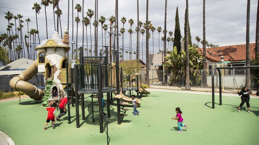 LOS ANGELES, CA - APRIL 16, 2019: Children play at the renovated Leslie Shaw Park in Jefferson Park