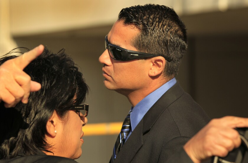 Gilbert Michel, the former Los Angeles County sheriff's deputy who smuggled a cellphone to a jail inmate in return for a bribe, outside a downtown L.A. federal court for a previous hearing in his criminal case.
