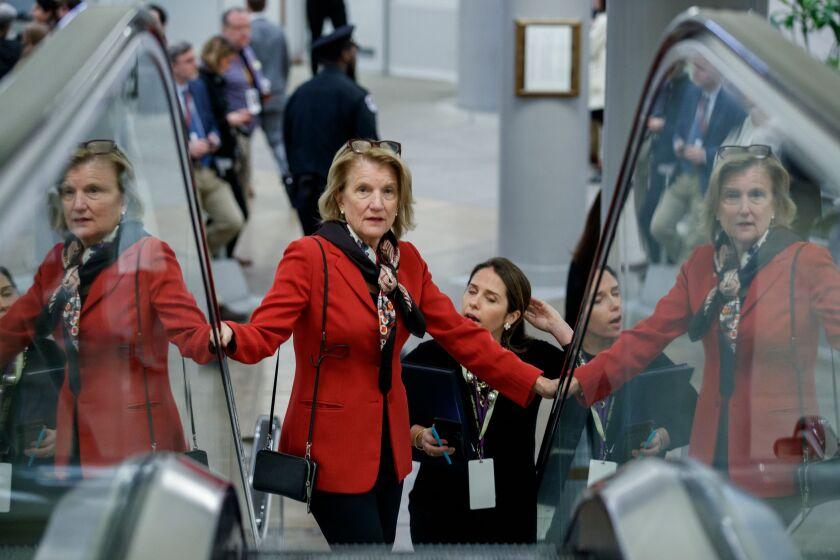 Sen. Shelley Moore Capito (R-W.Va.) rides up an escalator.