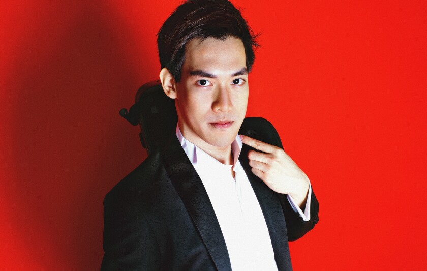 """Violinist Richard Lin """"impressed listeners with his beautiful tone and easy virtuosity"""" at a La Jolla Music Society concert Sunday."""