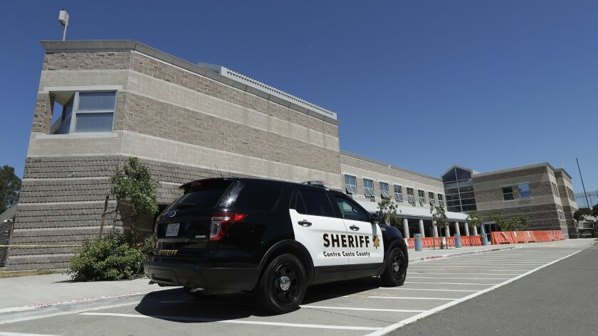A Contra Costa County Sheriff's vehicle is parked in front of the West County Detention Center in Ri