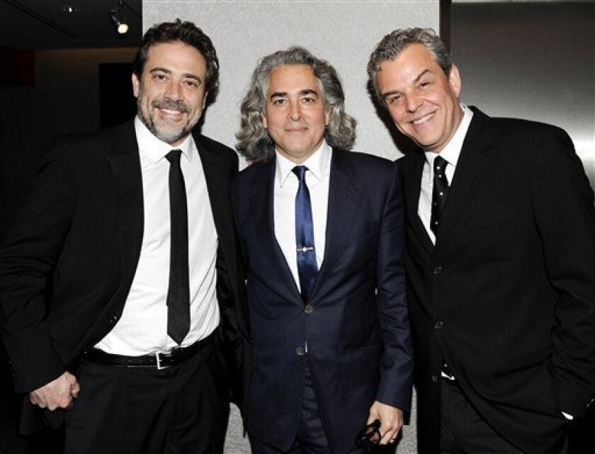 "FILE - In this March 22, 2012 file photo, actor Jeffrey Dean Morgan, left, poses with writer, creator and executive producer Mitch Glazer and actor Danny Huston, right, pose at the premiere of the Starz original series ""Magic City"" at The Academy Theater at Lighthouse International in New York. The series captures the fast life of Miami Beach fueled by the Rat Pack, the mob, the CIA and anti-Castro forces coalescing after Fidel Castro's rise to power in Cuba. (AP Photo/Evan Agostini, file)"
