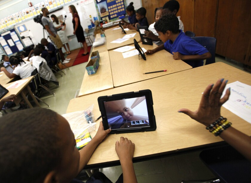 A student takes a picture of himself during a class at Broadacres Elementary School in Carson.