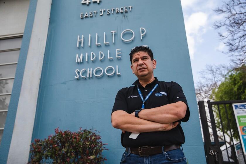 Principal Luis Aparicio stands in front of Hilltop Middle School in Chula Vista .