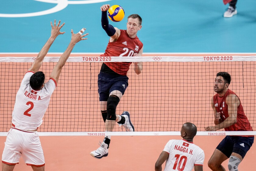 United States' David Smith spikes the ball during a men's volleyball preliminary round pool B match between United States and Tunisia at the 2020 Summer Olympics, Wednesday, July 28, 2021, in Tokyo, Japan. (AP Photo/Manu Fernandez)