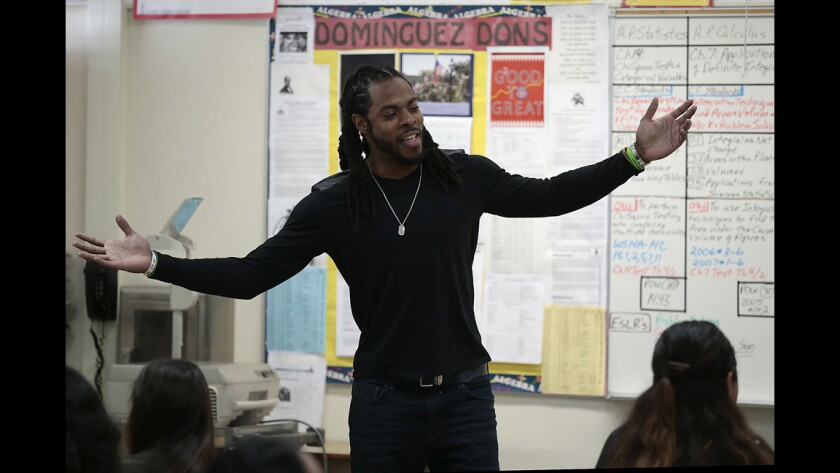 Richard Sherman is filmed while visiting the Dominguez High calculus class of teacher Paul Kreutz. Sherman, a graduate of Dominguez and Stanford University, credits Kreutz as being one his more influential teachers.