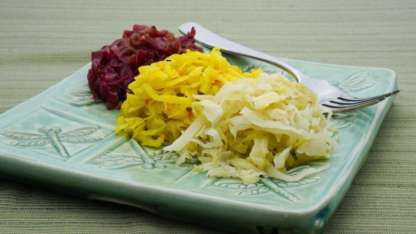 At his home in Encinitas, Curt Wittenberg serves a Curtido Rojo a Salvadoran cole slaw/sauerkraut di