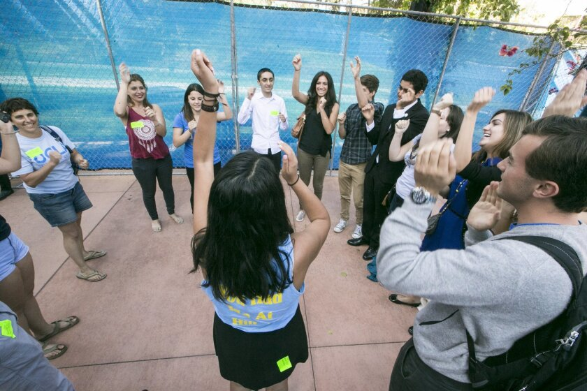 UCLA Students Against Anti Semitism cheer following a University of California's Board of Regents meeting at the Student Center to discuss a controversial policy statement on intolerance in Irvine, Calif., on Thursday, Sept. 17, 2015. The University of California's first draft of system-wide princi