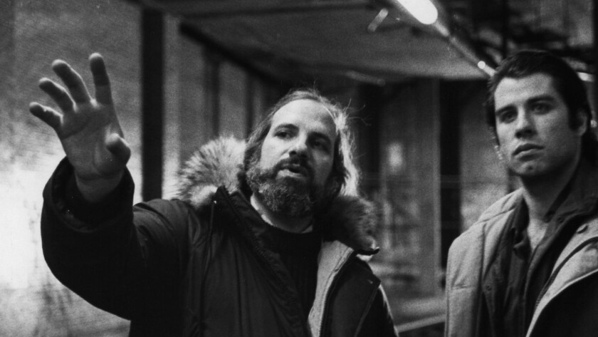 """Director Brian De Palma, left, and actor John Travolta on set of """"Blow Out"""" from the documentary """"De Palma."""""""