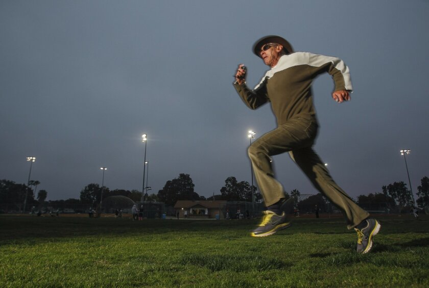 Alan Mindell, 72, practices sprinting at the Cardiff Sports Park in Encinitas earlier this month.