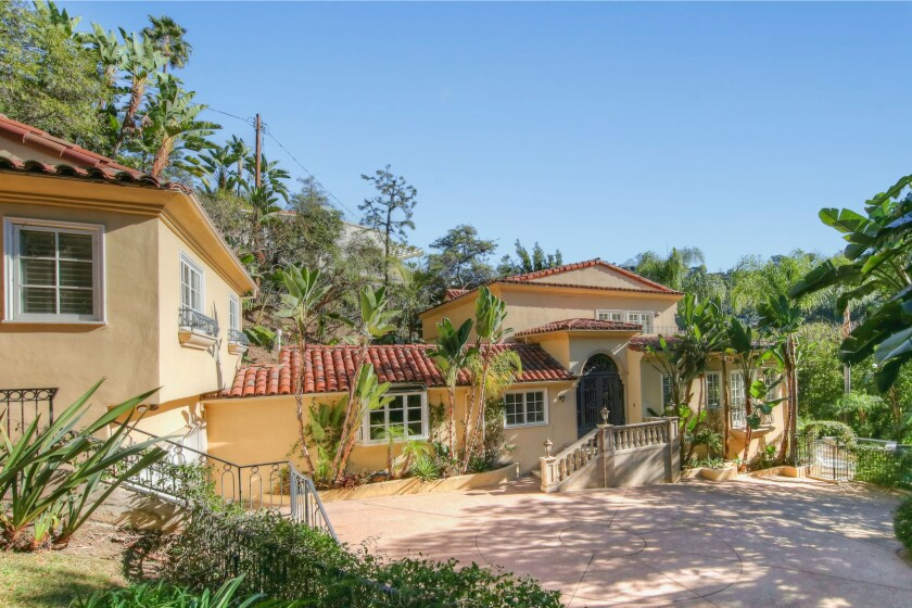 Built in 1923, the gated villa comes with a two-bedroom guesthouse and saltwater swimming pool.