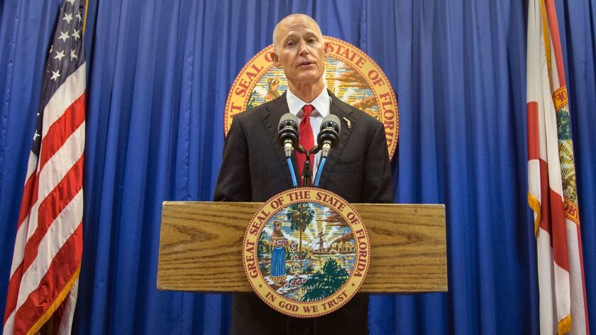 During a news conference in Tallahassee, Fla., on Feb. 23, Gov. Rick Scott proposed banning the sale of firearms to anyone younger than 21.