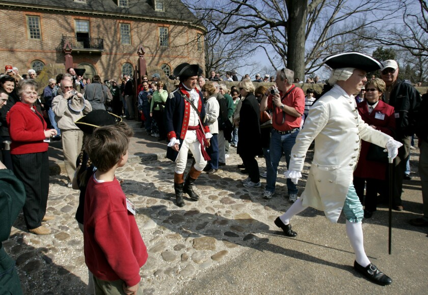 "In this Friday March 18, 2006 file photo, visitors to Colonial Williamsburg gather in the courtyard of the Colonial Capital as they watch the Royal Governor played by, Stephen Moore, right, a historical interpreter in a program called ""Revolutionary City"" in Williamsburg, Va."
