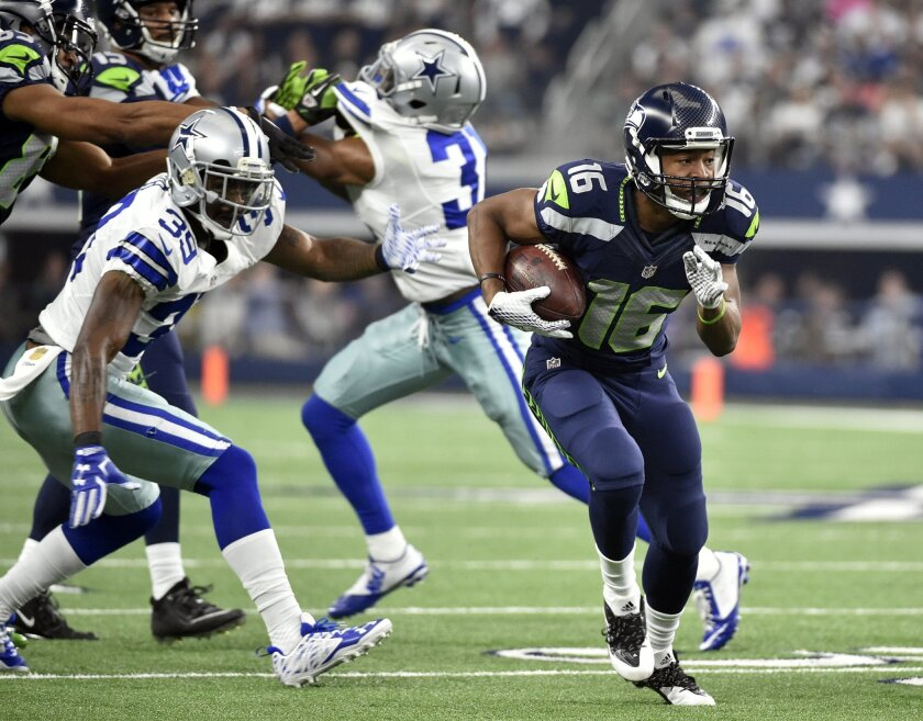 Seattle Seahawks wide receiver Tyler Lockett (16) gains yardage after a pass as Dallas Cowboys' Brandon Carr (39) gives chase in the first half of an NFL football game Sunday, Nov. 1, 2015, in Arlington, Texas. (AP Photo/Michael Ainsworth)