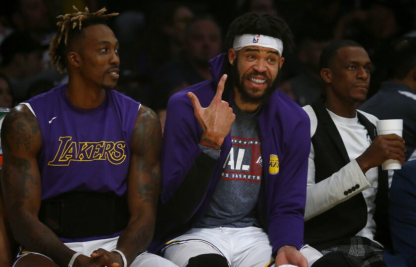 Veteran centers Dwight Howard, left, and JaVale McGee are having an enjoyable time with the Lakers this season.