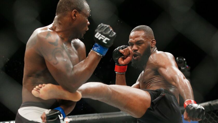 Jon Jones, right, kicks Ovince Saint Preux during UFC 197 in Las Vegas on April 23, 2016.