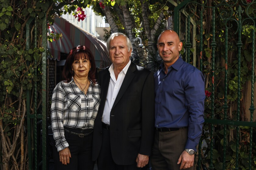 GLENDALE, CA--FEBRUARY 28, 2018: From left, Gohar, Rafik, and Armond Bakijanian stand in entrance of