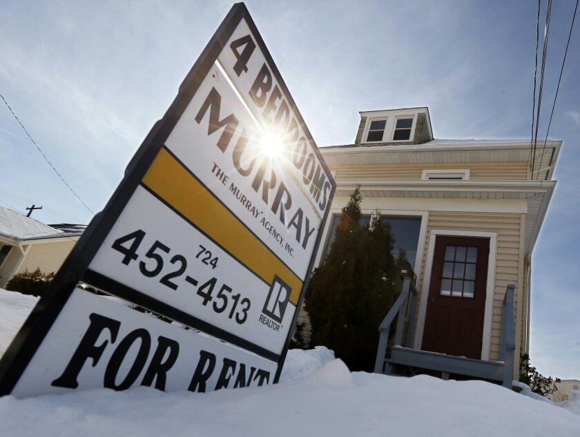 FILE - In this Wednesday, Feb. 25, 2015, file photo, a sign indicates a house for rent in Zelienople, Pa. On Friday, Jan. 22, 2016, real estate firm Zillow announces median home rental prices from December 2015. (AP Photo/Keith Srakocic, File)