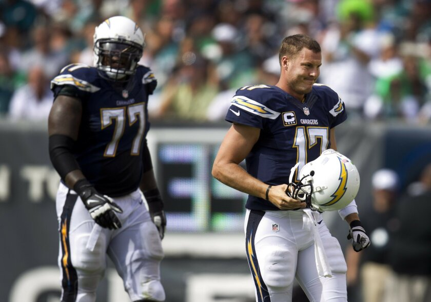 Unable to convert on this series in the third quarter, Chargers King Dunlap and Philip Rivers walk off the field.