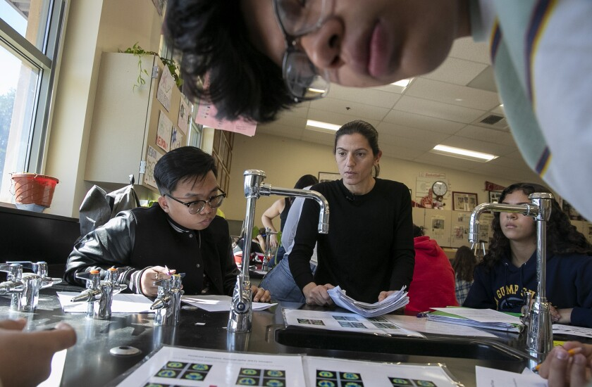 Burroughs biology teacher Vicky Oganyan helps students during a class Feb. 12.