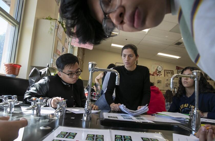 Burroughs biology teacher Vicky Oganyan helps students during a class Feb. 12.