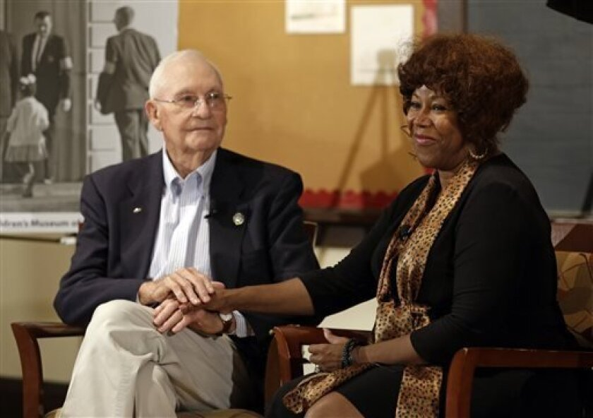 Ruby Bridges, right, who integrated Louisiana schools in 1960 under escort from U.S. Marshals, meets with Charles Burks, 91, who was one of those marshals at the Indianapolis Children's Museum in Indianapolis, Thursday, Sept. 5, 2013. The two filmed a video to share their experience with children. (AP Photo/Michael Conroy)