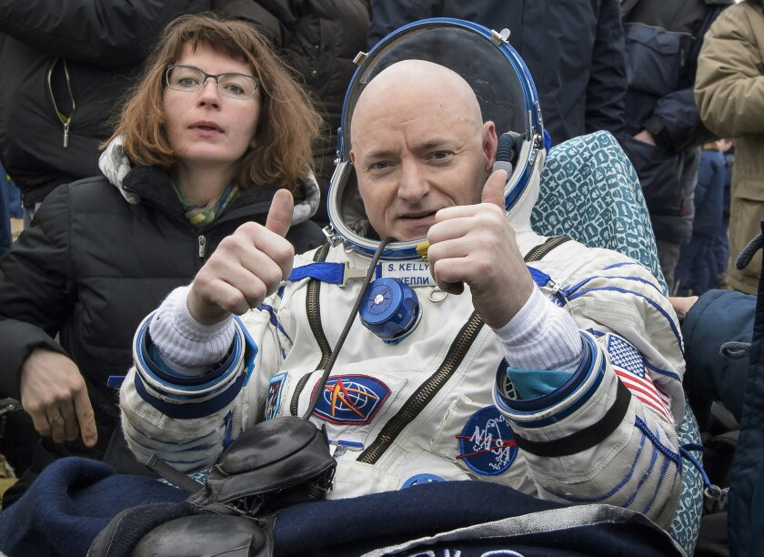 Astronaut Scott Kelly reacts after landing in Kazakhstan following nearly a year in space.