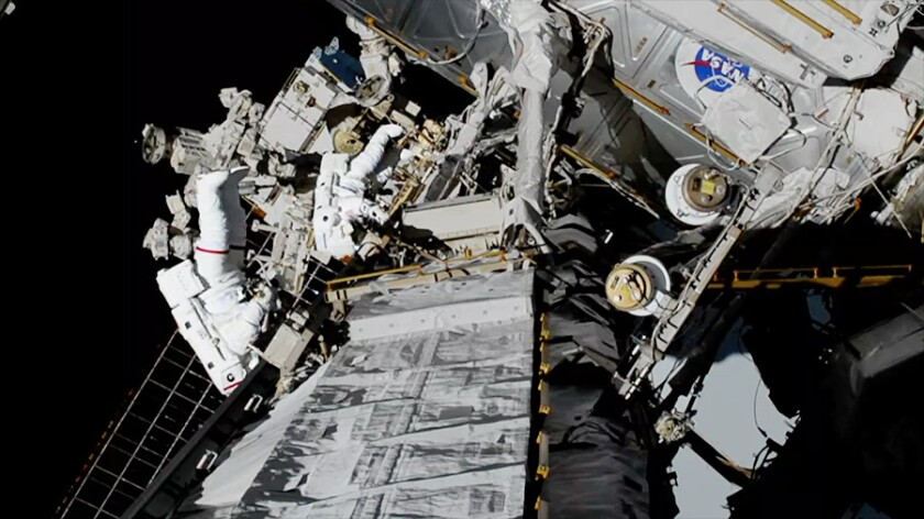 Astronauts Christina Koch (left) and Jessica Meir performed the first all-female spacewalk on Friday from the International Space Station.
