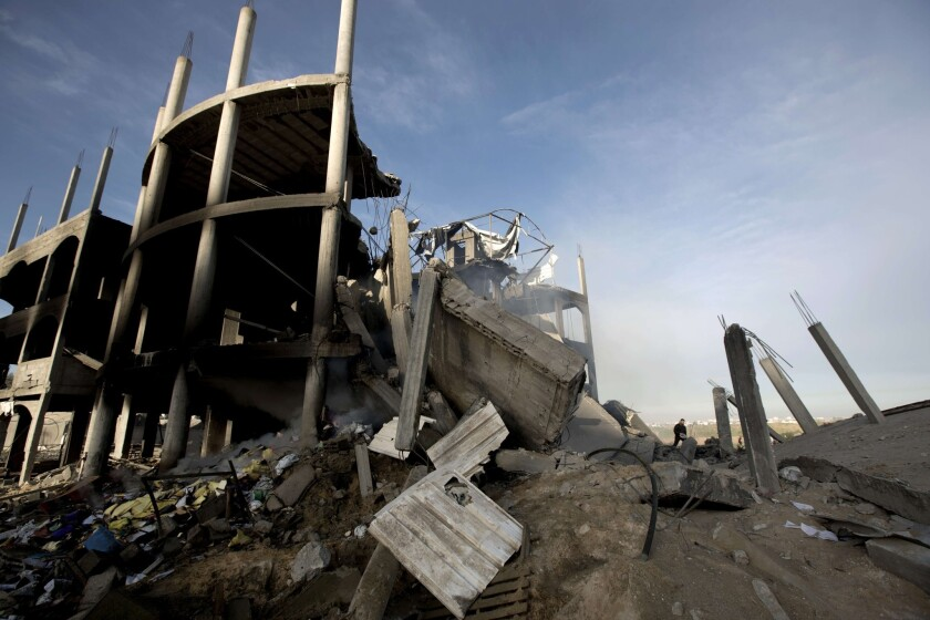 A building lies in ruins after an Israeli airstrike in Beit Lahiya, northern Gaza Strip.