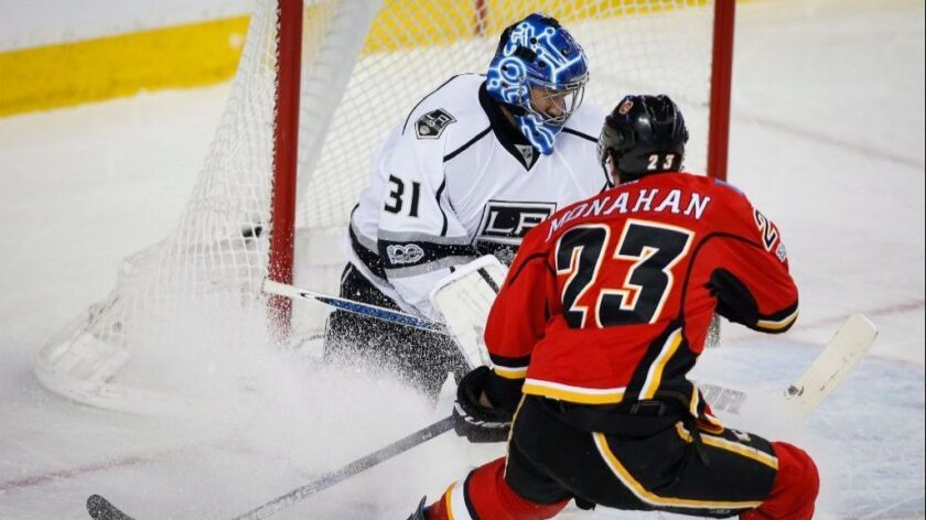 Kings goaltender Ben Bishop stops a shot from Flames center Sean Monahan during the first period of a game on Feb. 28.