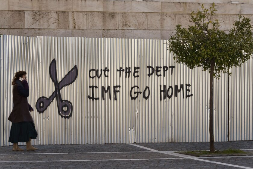 Graffiti adorns a fence in central Athens on Feb. 20 as European finance ministers prepared to meet again in search of a bailout compromise for Greece.