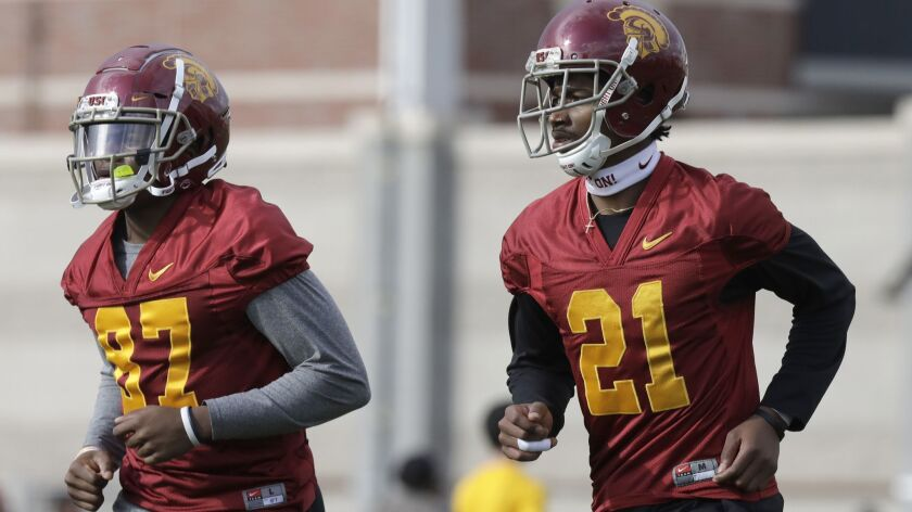 LOS ANGELES, CA -- MARCH 05, 2018: USC wide receivers John Jackson III, left, and Tyler Vaughns duri