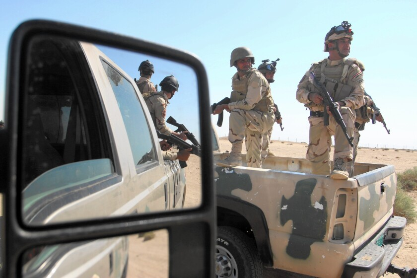 """Iraqi troops take part in tactical training in the southern city of Basra. """"We need more airstrikes, more training, new weapons,"""" said an Iraqi commander in Baghdad."""