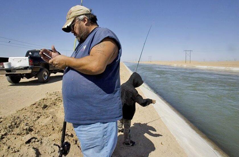 Michael Bagwell brought a friend's son, Carlos Cortes, to fish in the All-American Canal's new section. (Peggy Peattie / U-T)