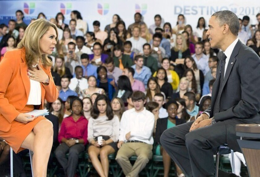 Univision news anchor Maria Elena Salinas with President Obama at a town hall at the University of Miami in Coral Gables, Fla. Obama discussed Latino-related issues including his difficulty in pushing through immigration reform.